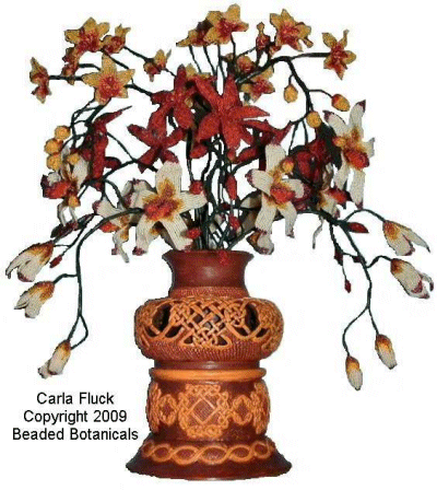 Three Orchids in Knotted Celtic Vase
